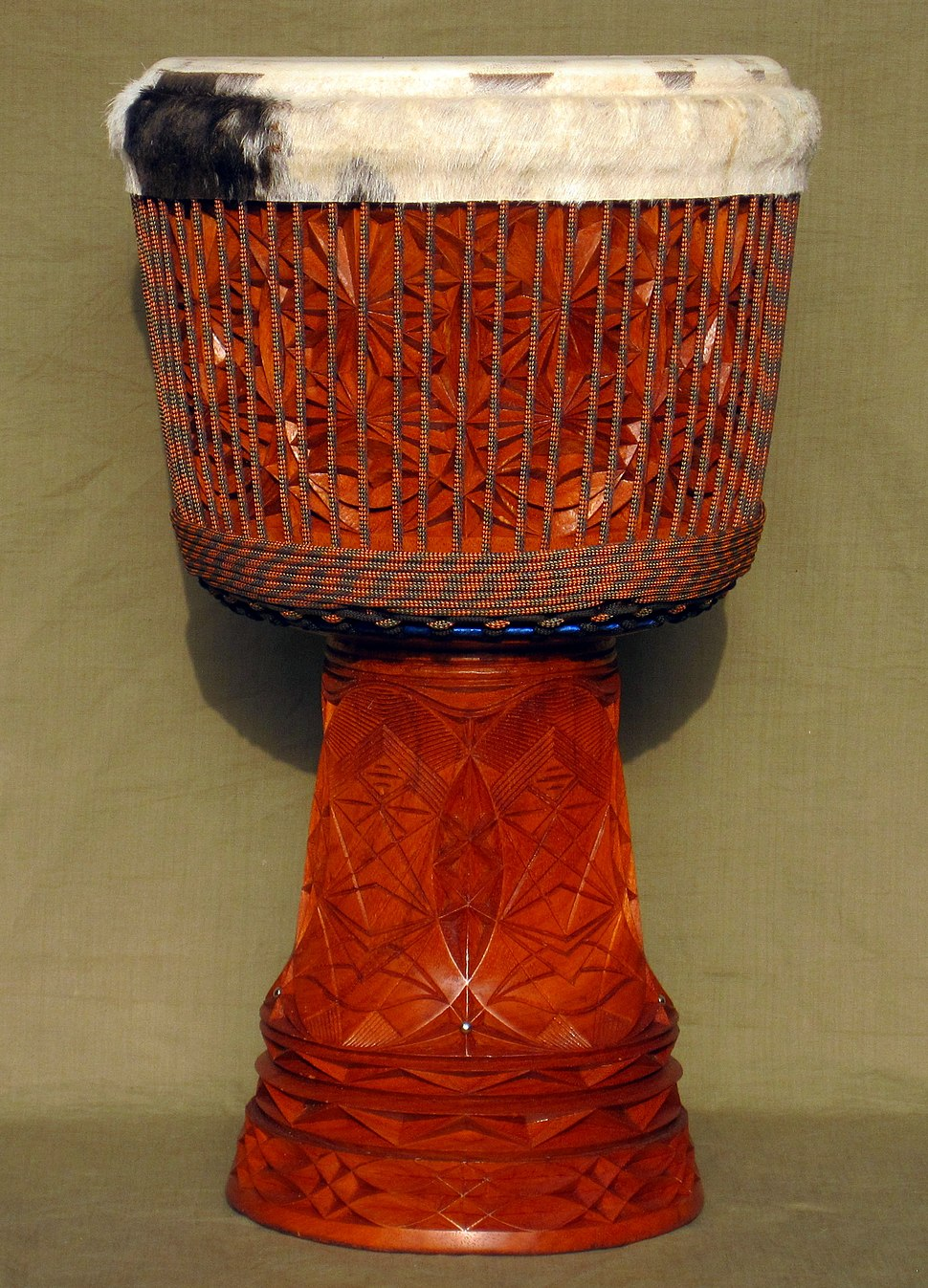 medium resolution of richly carved djembe