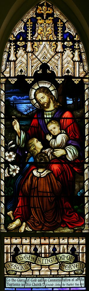 English: Stained glass panel in the nave of St...