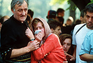 A family mourns during a funeral at the Lion's...