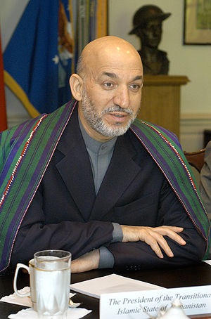 Afghan President Hamid Karzai meets with Secre...