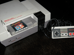 A NES console with the Super Mario Bros./Duck ...