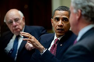 President Barack Obama, flanked by Paul Volcker and Jeffrey Immelt.