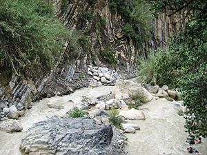 English: River and folded sedimentary rock at ...