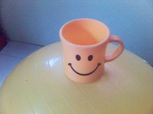 A smiley cup on a yellow ball.. =)