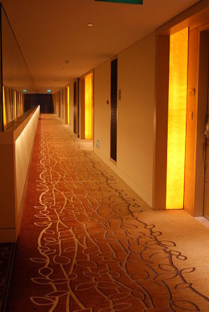 English: A corridor outside hotel rooms in the...