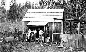 A Tulalip family in front of their home on the...