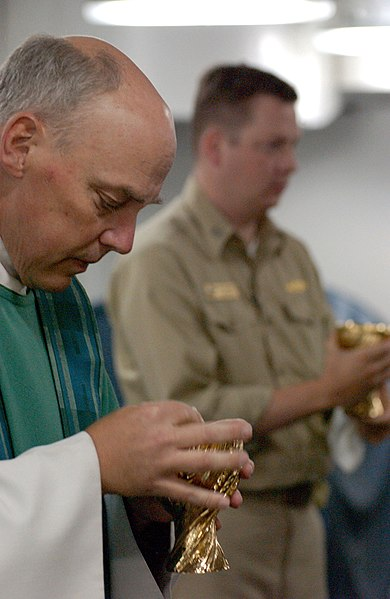 File:US Navy 030727-N-8148A-100 Lt. Richard House, Assistant Command Chaplain, (left) and Lt. Chris Chandler offer Holy Communion during the first underway Roman Catholic Mass aboard USS Ronald Reagan (CVN 76).jpg