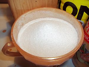 English: A bowl filled with sugar