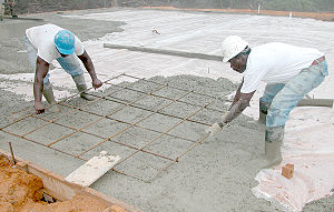 Installing rebar in a concrete floor during a ...