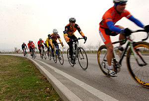 Military cyclists ride in a pace line as they ...