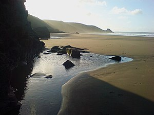 English: Calm morning on Newgale The sun just ...