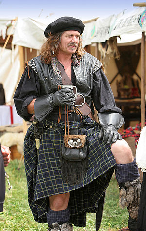 A belted plaid (rather than a kilt) as worn by...