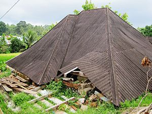A house destroyed in Padang Pariaman District,...