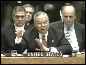U.S. Secretary of State Colin Powell holds a v...