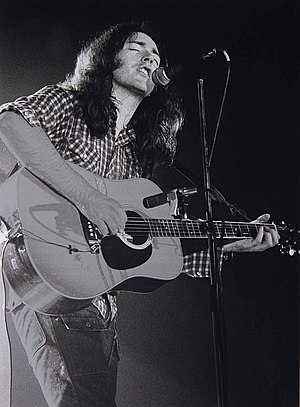 Gallagher on acoustic guitar, March, 1976, Bre...