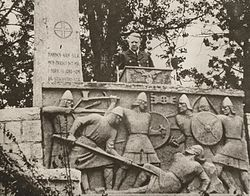 Nazi leader Vidkun Quisling in front of St Olaf monument with