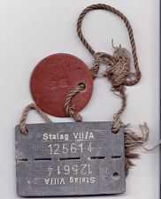 ID tag as worn by POWs. Name and service number are on the brown disc.