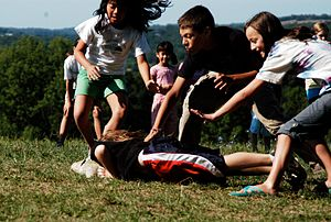 Children playing a variant of tag. In snatch t...