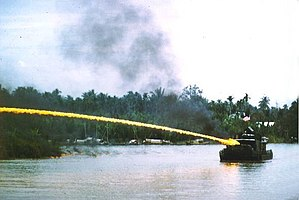 A U.S. riverboat deploying napalm during the V...