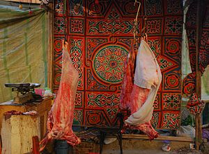 English: Selling meat at Id ul-Adha festival. ...