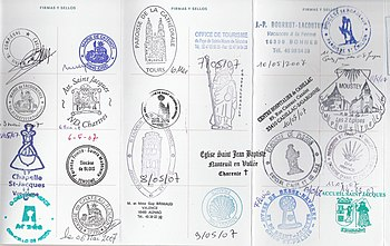St. James pilgrim passport stamps in France on...