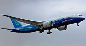The first 787, painted in Boeing's blue and white house colours, during the type's first flight. Landing gears and extended.
