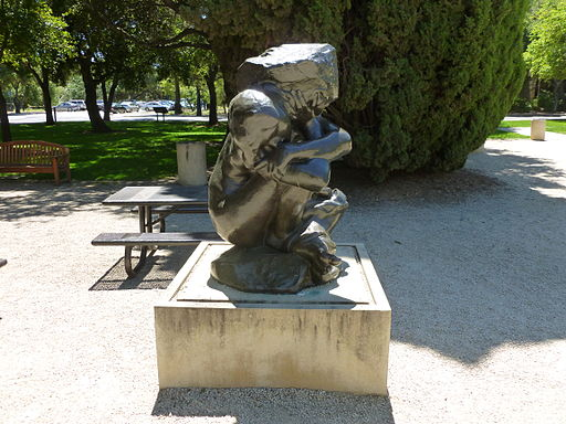 Fallen Caryatid with Stone; sculpture by Rodin; right side