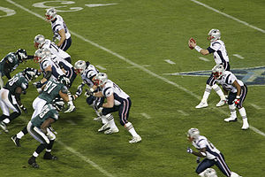 Tom Brady takes the snap during Super Bowl XXX...