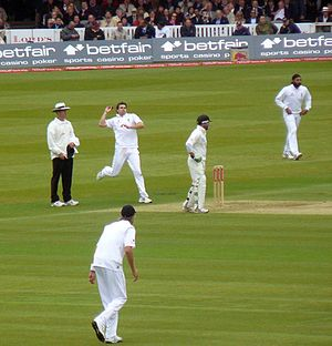 Jimmy Anderson in his delivery stride, bowling...