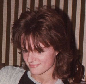 English: Girl with a typical 1980s hairstyle. ...