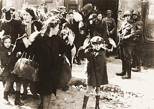 Warsaw Jews being held at gunpoint by SS troop...