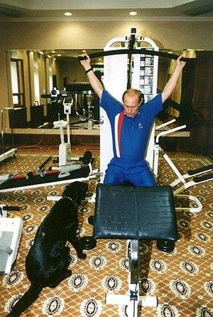 Vladimir Putin exercising whilst Koni (dog) wa...