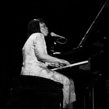 English: American jazz pianist, organist, voca...