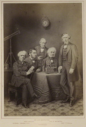 Photograph of (left to right): Michael Faraday...