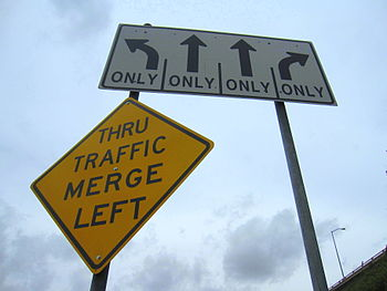 English: Confusing street signs directing traf...