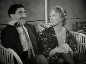 English: Groucho Marx & Eve Arden in At the Ci...