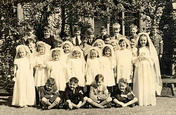 Group portrait of children at their First Comm...