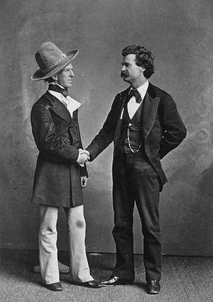 Mark Twain in a handshake with John T. Raymond...