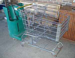 English: Shopping cart with seating for 3 chil...