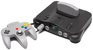 A Nintendo 64 video game console shown with gr...
