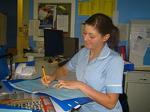 British nurse in nurses' station.