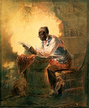English: Black man reading newspaper by candle...