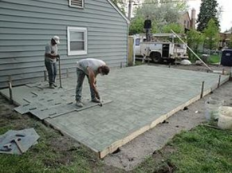 275px Concrete being stamped