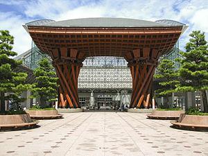 Wooden Tsuzumi Gate and glass facade of Kanaza...