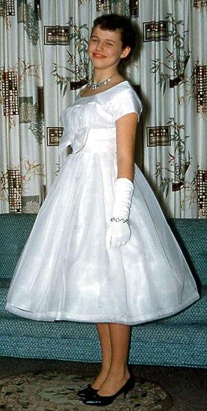 English: Girl in prom dress, USA, 1950s.