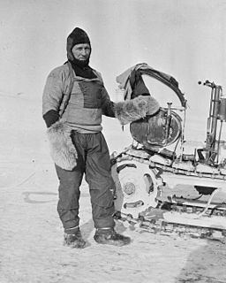 William Lashly standing by a Wolseley motor sleigh during the British Antarctic Expedition of 1911-1913, November 1911