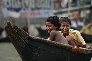 Bangladeshi children on canoe in Dhaka.
