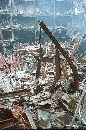 English: World Trade Center cross in the debri...