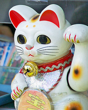 This maneki neko beckons customers to purchase...
