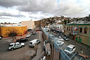 The towns of Nogales, Ariz., left, and Nogales...